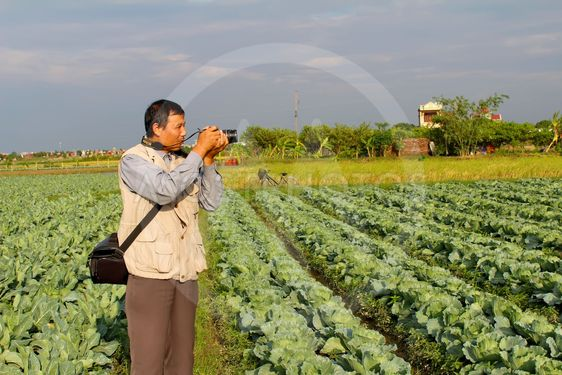 reporter take photo in the field