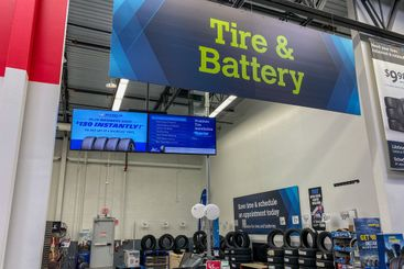 The Tire and Battery aisle of a Sams Club Wholesale...