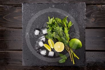 Top view of ice cubes and mojito cocktail ingredients on...