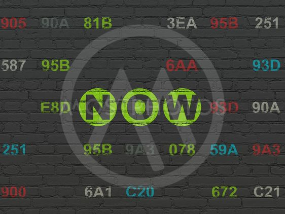 Time concept: Now on wall background