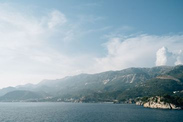 View from the sea to the coast of Budva, Becici and...
