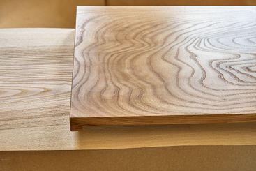 Elm slab countertop with stylish texture in workshop