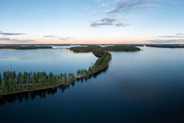 Beautiful ridge road between lakes in Saimaa in summer.