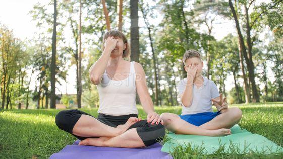 Photo of middle aged female yoga teacher or guru...