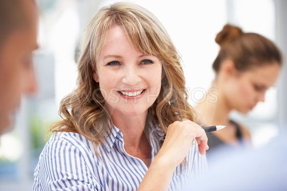 Mid age businesswoman in meeting