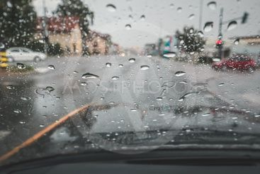 Raindrops on a windshield.