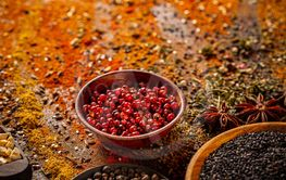 Red peppercorn in wooden bowl