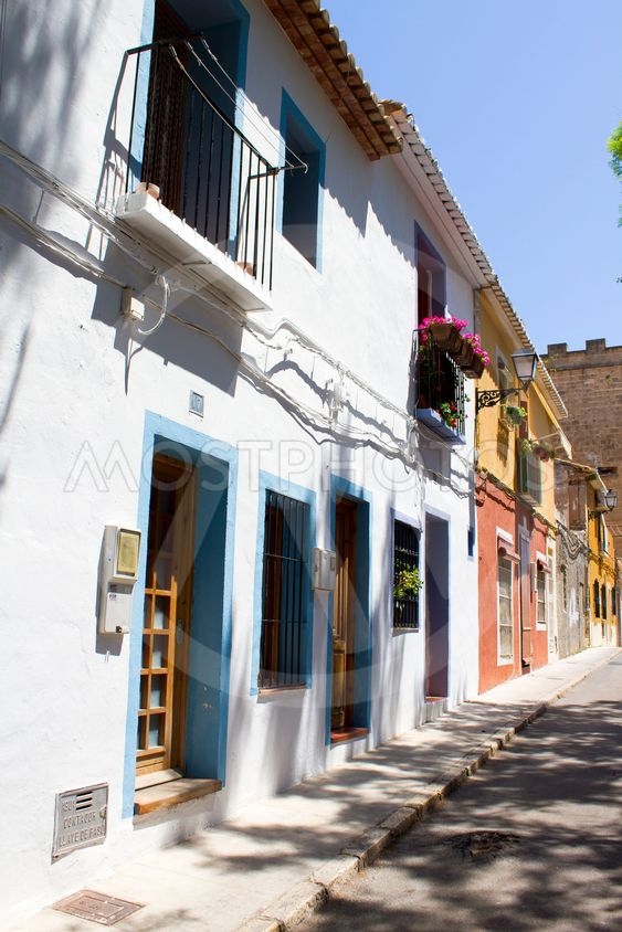 Spanish street with typical houses in Denia, Spain