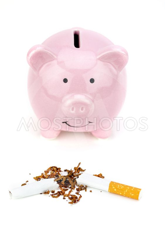 Cigarette cut in half and piggy bank. Stop smoking...