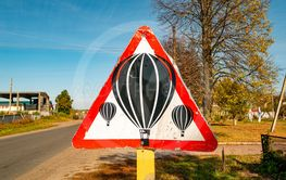 Balloons are flying - warning road sign.