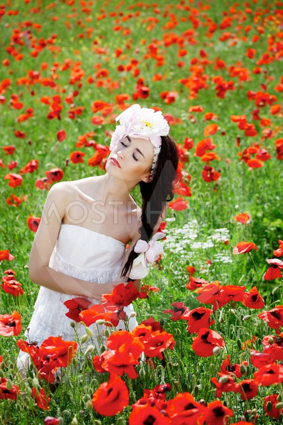Beautiful girl in poppies