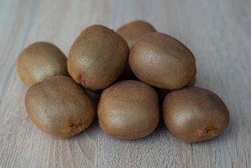 Group of ripe whole green kiwi fruit