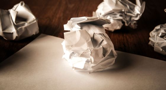still life of paper and a crumpled paper on a table