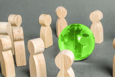 People surrounded a green Globe world planet earth....