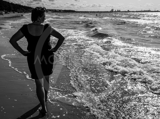 Mature blonde enjoying the sea