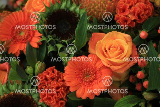Mixed orange wedding arrangement