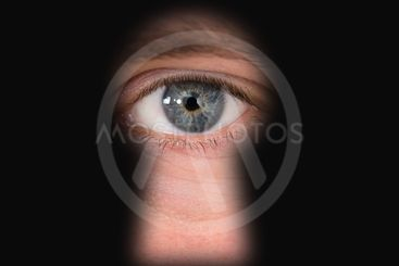 Person Looking Through Keyhole