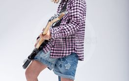 Gifted young schoolgirl playing electric guitar