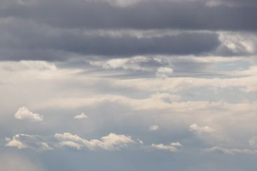Grey and white clouds in an atmosphere image.