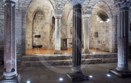 Crypt of a medieval abbey with carved stone columns.