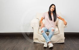 Young woman with ripped jean