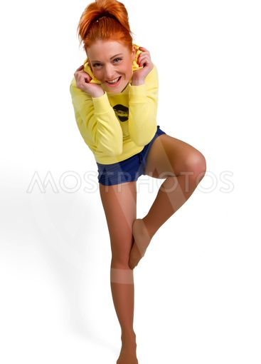 woman stand on one leg in yoga pose
