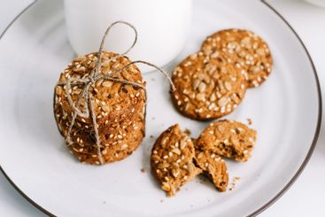 Oatmeal cookies with a carafe of milk on a white plate