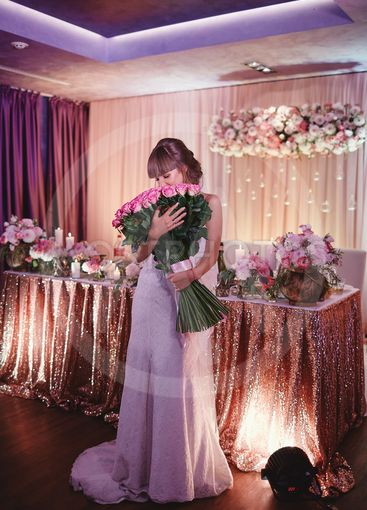 happy bride with a large bouquet of roses. beautiful...