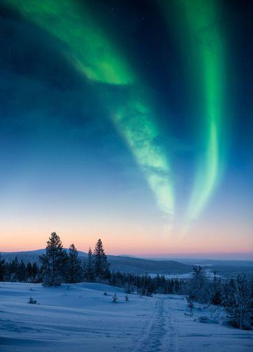 Epic landscape in Pallastunturi mountain with aurora