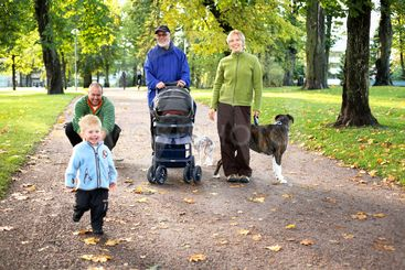 three generations and dog in park