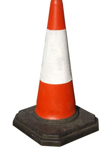 British traffic road works cone isolated on white.