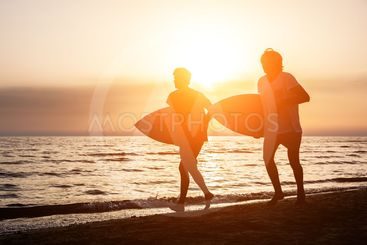 Two Boys with Surf Boards at Sunset