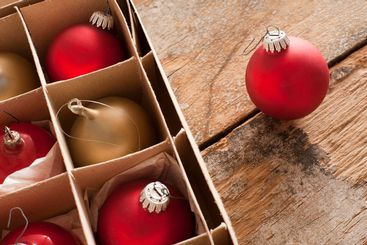 Red and gold Christmas baubles in a box