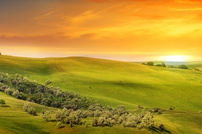 scenic fields, hills and sunrise