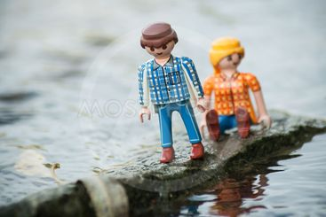 PLaymobil characters on rock in middle of the river in...