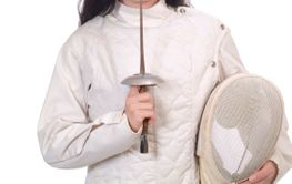 Young Woman in Fencing Jacket with Foil and Mask