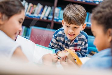 kids reading books in library