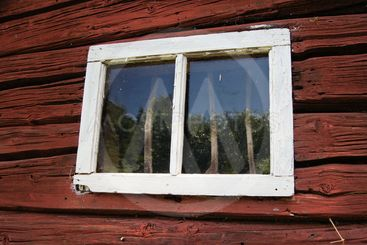 Window of an old wood house of stocks.