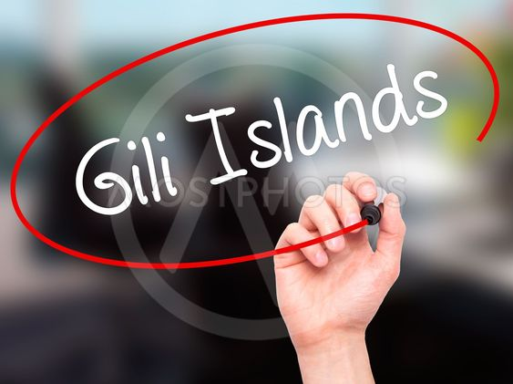 Man Hand writing Gili Islands with black marker on visual...