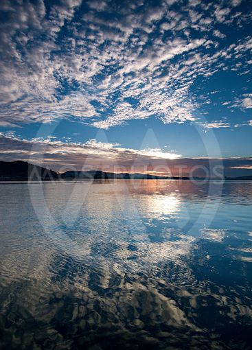 Blue sky Reflections Sunrise Waterscape.