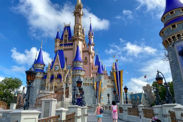 People walking up to Cinderella's Castle in the Magic...