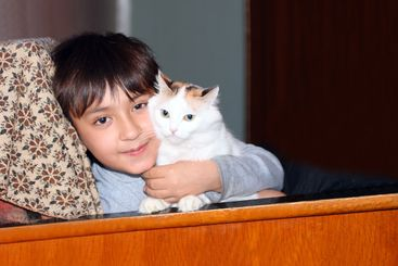 asian boy with cat