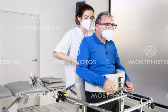 Physiotherapist assisting a patient with Amyotrophic...