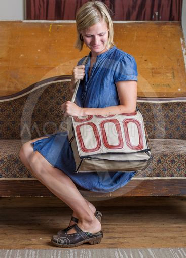 Blonde Woman With Cream and Red Patterned Purse