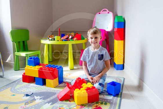 Kid playing with construction blocks