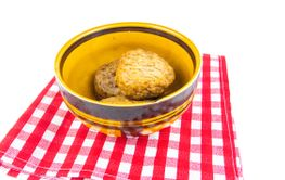 Meat cutlets in a plate on a white background.