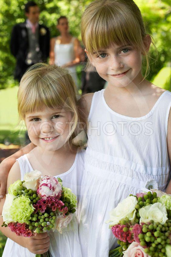 Cute Little Bridesmaids Holding Bouquets