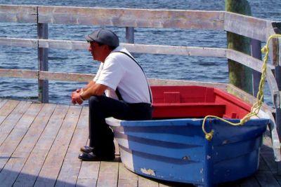 Men resting on a boat