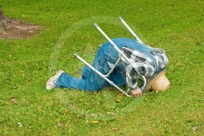 man with a walker falling