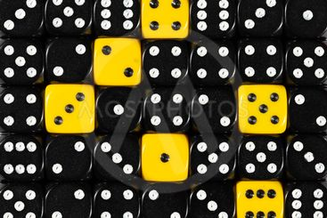 Background of random ordered black dices with six yellow...